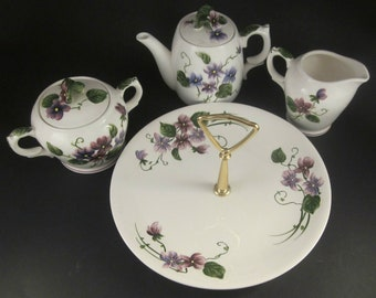 Beautiful Lefton's 6 piece Tea Set in SWEET VIOLET, each piece is marked Sweet Violets and is numbered.