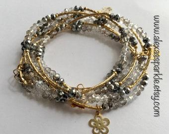 Metallic silver transcendent beaded bracelets with gold plated charms - Semanario plateado metalico transendente con dijes de chapa de oro