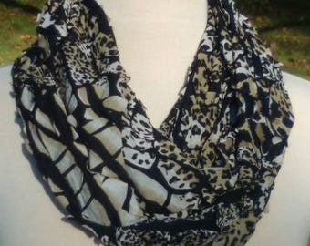 Animal print Infinity scarf, textured knit fabric loop scarf, black white and beige animal print scarf, stretchy knit circle scarf.