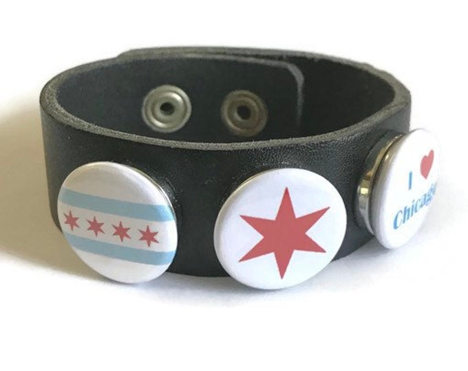Chicago Themed Snap Interchangeable Cuff Bracelet Features Three Interchangeable Chicago Themed Snaps and Adjustable Leather Cuff