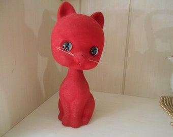 red faux cat bobble head bank
