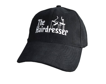 The Hairdresser Godfather Parody Style White Embroidery Design on an Adjustable Structured Black Baseball Cap in Herringbone Textured Fabric