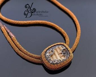Bolo with a simbircite fossil. Mens tie beadwork gemstone jewelry. Beading tie. Bolo tie bead embroidery.