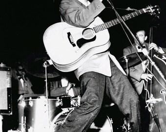 Elvis Presley - Elvis on stage in the 1950's. # 2