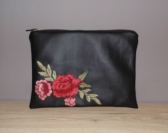 Black leather clutch bag with flower