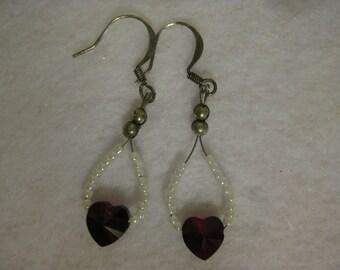 Earrings with purple swarovski hearts