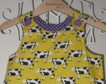 Reversible Dress, girls pinafore, yellow cow print retro style, shift dress, 2 in 1, chintzy, purple polka dot, funky, cow design,