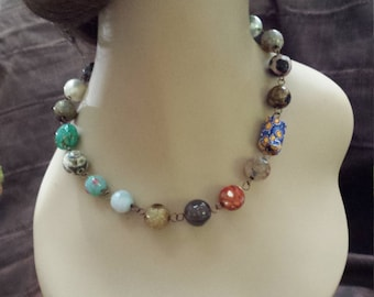 One strand assorted beaded faceted necklace