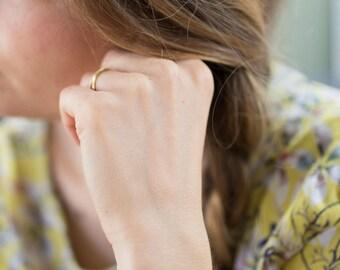 Bracelet grappe doré à l'or fin et pierre