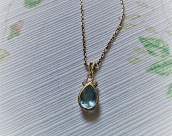 Blue Topaz in 14K Gold with small Diamond Highlight on 14K Chain
