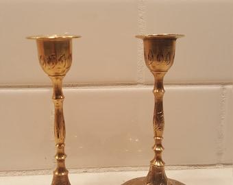 Small, brass candlestick holder set