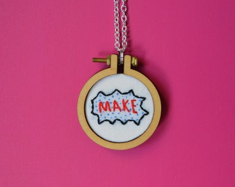 "Embroidered necklace of ""make"" in comic book style"