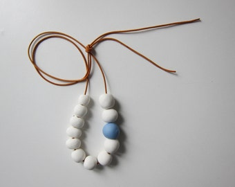 Unique handmade porcelain bead necklace, snow white and sky blue roundish beads and brown leather cord