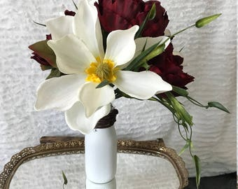 Artificial Floral Arrangement with Magnolias and Peonies in a Painted Milk Jar