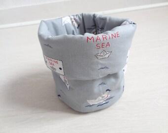 Padded basket, sailor Teddy bear: diaper, wipes, baby storage