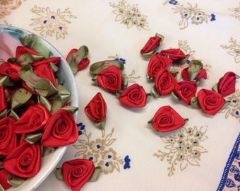 Red silk flowers etsy satin red rosettes miniature roses red rosettes satin rosettes red silk flowers mightylinksfo Choice Image