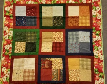 """Baby Quilt (34"""" x 34"""") - apple themed with scrappy squares and a light green backing"""
