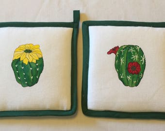 Pair of pot holders with application of hand painted cactus