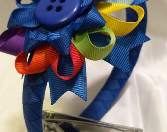 Daisy Scout inspired blue headband with multi colored bow