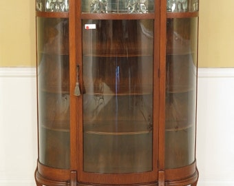 F28329E: Antique Oak Bow Front China Cabinet W. Leaded Glass