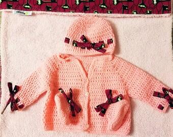 Ankara baby girl gift set. Ankara receivable blanket. Ankara crochet cardigan. Ankara baby cap and bootie.