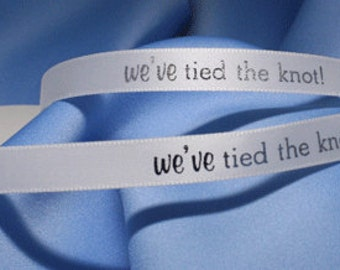 """3/8"""" x 5 Yards White Satin Ribbon with """"We've Tied the Knot"""" Silver Metallic Imprint"""