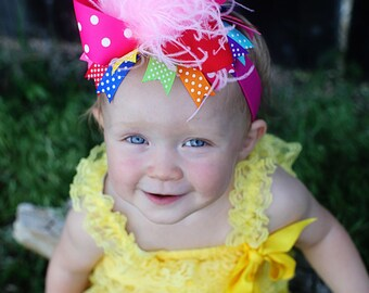 boutique RAINBOW PLUS over the top hair bow on a headband