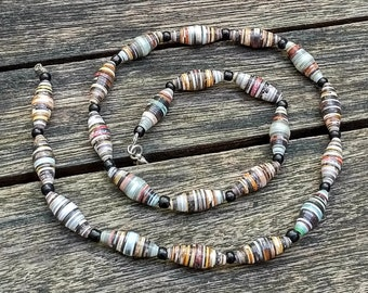 Handmade necklace with multicolor black - light blue - grey - brown -  green recycled paper and black glass beads
