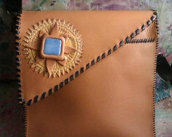 Leather handbag, floral crimp