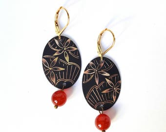 Oval earrings etched brass with a floral reminiscent of lace.