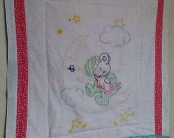 Sleepy bear on moon lap quilt