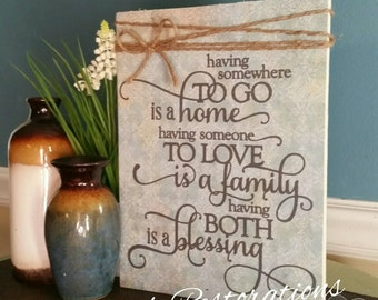 Wooden sign with scripture, Having somewhere to go is home, having someone to love is a family, having both is a blessing, religious sign