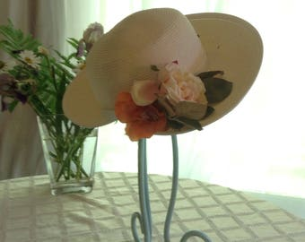 Pretty white straw hat with peach roses