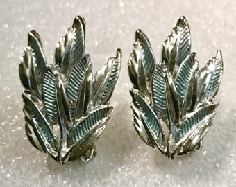 Vintage jewelry silver leafs earrings mid century clip light blue highlights