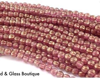 Czech Glass Melon Bead, 5mm Round, 50 bead strand, Halo Cherub (rose gold luster)