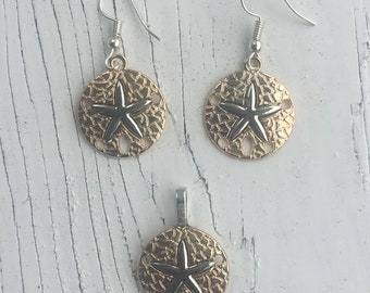 Gold and Silver Sand dollar & Starfish pendant and pierced earing set. All 3/4 inches wide. Set SD-1