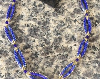 Blue and gold cylinder beads and blue beaded necklace
