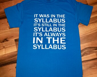 It is in the Syllabus Tee Shirt, Teacher Gift, Teacher Shirt