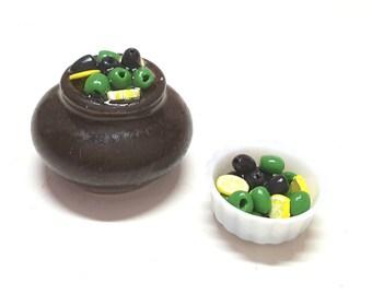 Porcelain pot of olives