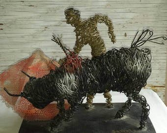 Brutalist Wire Folk Art by Dominican Republic Artist C. Serraty. This is a Wire Production of a Matador and Bull. Nicely done by the Artist.