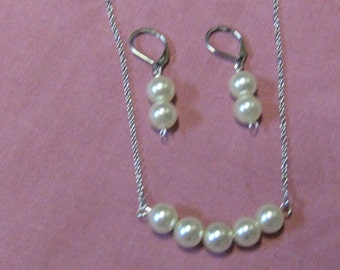 Pearl necklace and earring set.