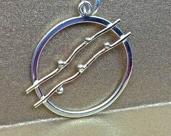 Sterling silver and 14k yellow gold pendant