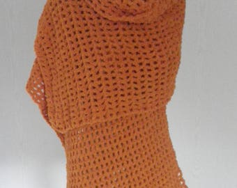 orange shawl crocheted for cool evenings