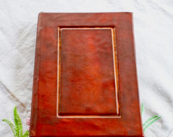 Leather journal hard backed.