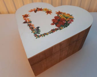 Box heart decorated with a Garland of flowers mosaic of postage stamps