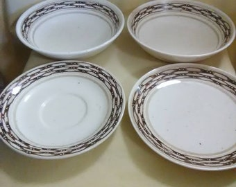 Vintage brown and tan bowls and saucers. USA. Stoneware.