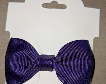 Small purple hairbow on a clip