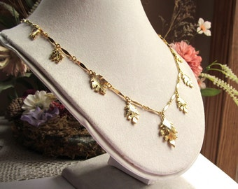 24 Inch Gold Plated Bar Link Necklace with Graduated Leaf Charms