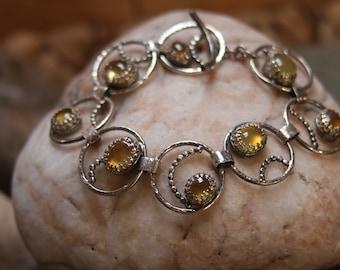 Handmade silver bracelet with yellow sapphire