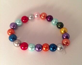 Beaded Bracelet - Handmade with multicoloured beads and elasticated string item #008 by CraftyLittleMonkeyGB